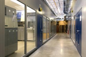 Double Skin Steel Partitioning to Form Production Offices c/w Full Height Glass