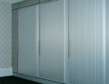 Storage Wall With Sliding Tambours