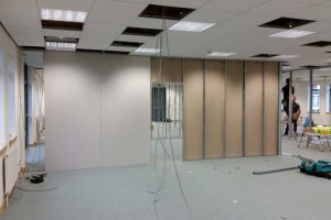 Solid office partitions being erected